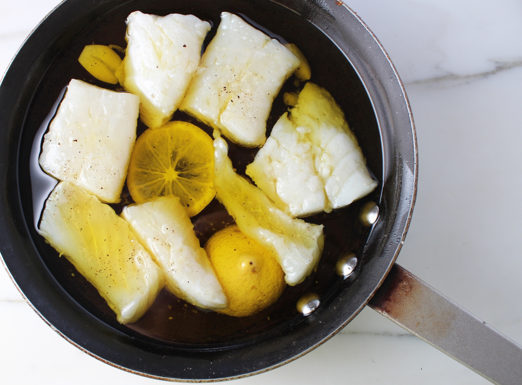 Poached Cod in Olive Oil