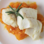 poached cod on plate